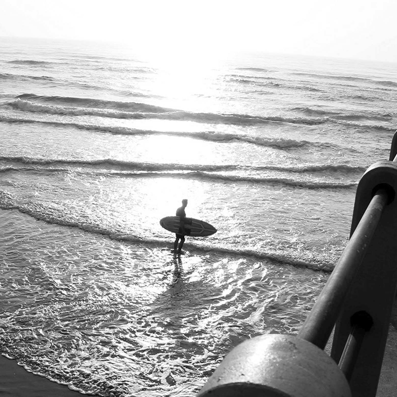 silhouette of a pro surfer